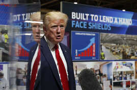President Donald Trump speaks as he tours Ford's Rawsonville Components Plant that has been converted to making personal…