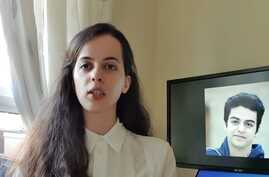 Screen grab of May 5, 2020, Twitter video in which Aida Younesi, Britain-based sister of student Ali Younesi whom Iranian authorities detained on April 10, 2020, criticizes Iran's treatment of her brother, seen on screen behind her.