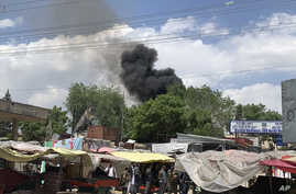 Smokes rises from a hospital after gunmen attacked in Kabul, Afghanistan, May 12, 2020.