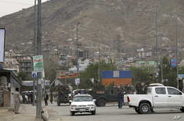 Afghan security forces inspect the site of a bomb explosion in Kabul, May 18, 2020.