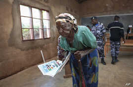 A woman walks to the polling booth to cast her vote in the presidential election, in Giheta, Gitega province, Burundi, May 20, 2020.