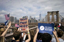 FILE - Pro-gun control demonstrators march across the Brooklyn Bridge in New York, June 14, 2014. The Everytown for Gun Safety advocacy group has part of its roots in New York, having been co-founded by former Mayor Michael Bloomberg.
