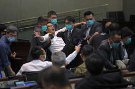 Pan-democratic legislator Lam Cheuk-ting is taken away by security during a Legislative Council's House Committee meeting in Hong Kong, May 18, 2020.