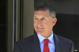 FILE - Former Trump national security adviser Michael Flynn leaves the federal courthouse in Washington, following a status hearing, July 10, 2018.