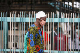 FILE - A man wearing a protective face mask is seen on the first day of the easing of coronavirus lockdown measures, in Lagos, Nigeria, May 4, 2020.
