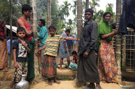 FILE - Rohingya refugees from Myanmar are seen outside their makeshift homes near Kutapalong refugee camp in the Cox's Bazar district of Bangladesh, Feb. 9, 2018.