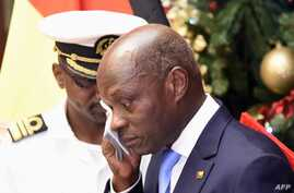 Guinea Bissau's president Jose Mario Vaz reacts as he delivers his New Year's speech on December 31, 2019 at the Presidential…