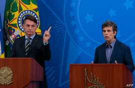 Handout picture released by Agencia Brasil showing Brazil's President Jair Bolsonaro (L) and his new Health Minister Nelson…