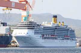 In this picture taken on April 22, 2020, cruise ship Costa Atlantica is docked at a port in Nagasaki. - At least 48 crew aboard…