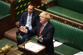 A handout photograph released by the UK Parliament shows Britain's Prime Minister Boris Johnson attending Prime Minister's…