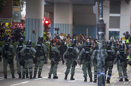 Riot police stand guard in Hong Kong