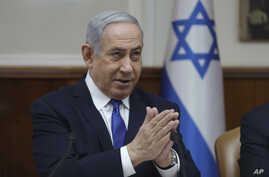 File - In this Sunday, Dec. 29, 2019 file photo, Israeli Prime Minister Benjamin Netanyahu attends the weekly cabinet meeting…