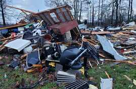 This photo provided by Bossier Parish Sheriff's Office shows damage from Friday nights severe weather, including the home of an…