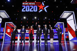 From left, Democratic presidential candidates, former New York City Mayor Mike Bloomberg, former South Bend Mayor Pete…