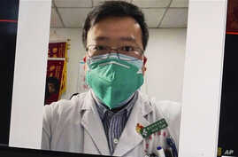 This image from video, shows a selfie of Dr. Li Wenliang. The Chinese doctor who got in trouble with authorities in the…