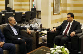 Lebanese Prime Minister Hassan Diab, right, meets with Iranian Parliament Speaker Ali Larijani, in Beirut, Lebanon, Monday, Feb…