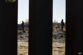 Mexican National Guard troops patrolling the country's northern border are seen from Sunland Park, New Mexico on Friday, Jan…