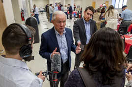 Jeff Sessions talks with the media as he campaigns at a Jefferson County GOP candidate pancake breakfast, Saturday, Feb. 29,…