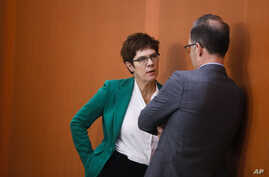 Christian Democratic Union party chairwoman and Defense Minister Annegret Kramp-Karrenbauer, left, talks with Foreign Minister…