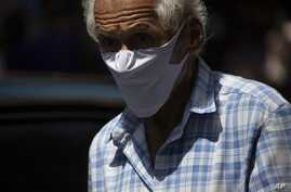 A man wears a homemade face mask as a preventive measure against the spread of the new coronavirus in Caracas, Venezuela,…