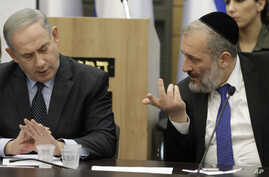 Israeli Prime Minister Benjamin Netanyahu listens to Israeli Interior Minister Aryeh Deri during a meeting with his nationalist…