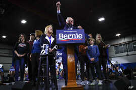 Democratic presidential candidate Sen. Bernie Sanders, I-Vt., accompanied by his wife Jane O'Meara Sanders and other family…