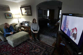 Lally Doerrer, right, and Katharine Hildebrand watch Joe Biden during his Illinois virtual town hall, in Doerrer's living room…