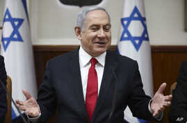 Israeli Prime Minister Benjamin Netanyahu chairs the weekly cabinet meeting in Jerusalem, Sunday, March. 8, 2020. (AP Photo…