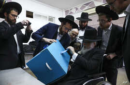 Ultra-orthodox man votes during elections in Bnei Brak, Israel, Monday, March 2, 2020. (AP Photo/Oded Balilty)