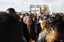 Democratic presidential candidate Mike Bloomberg, walks across the Edmund Pettus Bridge in Selma, Ala., Sunday, March 1, 2020,…