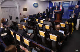 Reporters as questions of President Donald Trump as he speaks about the coronavirus in the James Brady Press Briefing Room of…
