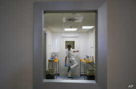 A doctor disinfects his shoes as he leaves the ICU unit of Rome's San Filippo Neri Hospital's Covid department,  in Rome,…