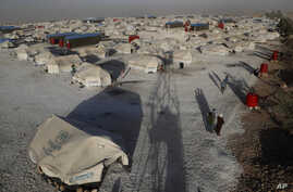 A general view of a refugee camp where Syrian displaced people who fled with their families the battle between U.S.-backed…
