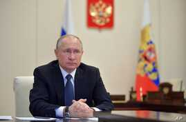In this photo taken on Tuesday, April 7, 2020, Russian President Vladimir Putin, during a meeting at the Novo-Ogaryovo…
