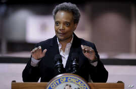 Chicago Mayor Lori Lightfoot speaks during a news conference in Hall A at the COVID-19 alternate site at McCormick Place in…