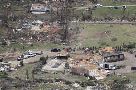 Debris is scattered from damaged homes Tuesday, April 14, 2020, in Chattanooga, Tenn. Tornadoes went through the area Sunday,…