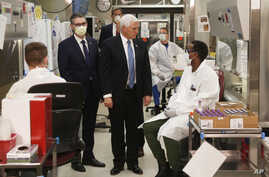 Vice President Mike Pence visits the molecular testing lab at Mayo Clinic Tuesday, April 28, 2020, in Rochester, Minn., where…
