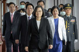 In this photo released by the Taiwan Presidential Office, Taiwanese President Tsai Ing-wen, center, walks ahead of Vice…