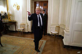 President Donald Trump gestures as he leaves a meeting with restaurant industry executives about the coronavirus response, in…