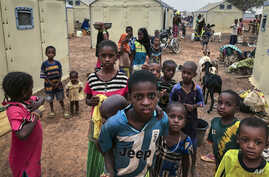 Children of around 6,000 ethnic Fulanis who have been displaced by attacks, gather in a makeshift camp for the displaced in…