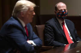 Colorado Gov. Jared Polis listens as President Donald Trump speaks during a meeting on the coronavirus response, in the Cabinet…