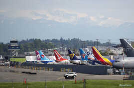 Various models of the Boeing 737 sit parked on the tarmac at Boeing Field after coming off the production line in Seattle,…