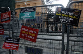 Placards are attached on security barriers outside the Russian Consulate following a protest against killing of Turkish…