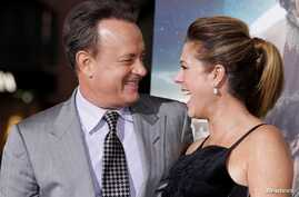 """FILE PHOTO - Actor Tom Hanks, one of the stars of the new film """"Cloud Atlas,"""" poses with wife, actress Rita Wilson, as they…"""