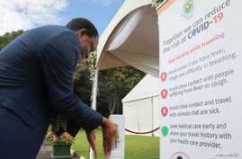A man disinfects his hands against the spread of coronavirus disease (COVID-19) at State House in Harare, Zimbabwe, March 19,…