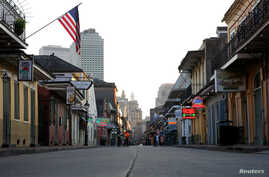 FILE PHOTO: A view of Bourbon Street amid the outbreak of the coronavirus disease (COVID-19), in New Orleans, Louisiana, U.S…