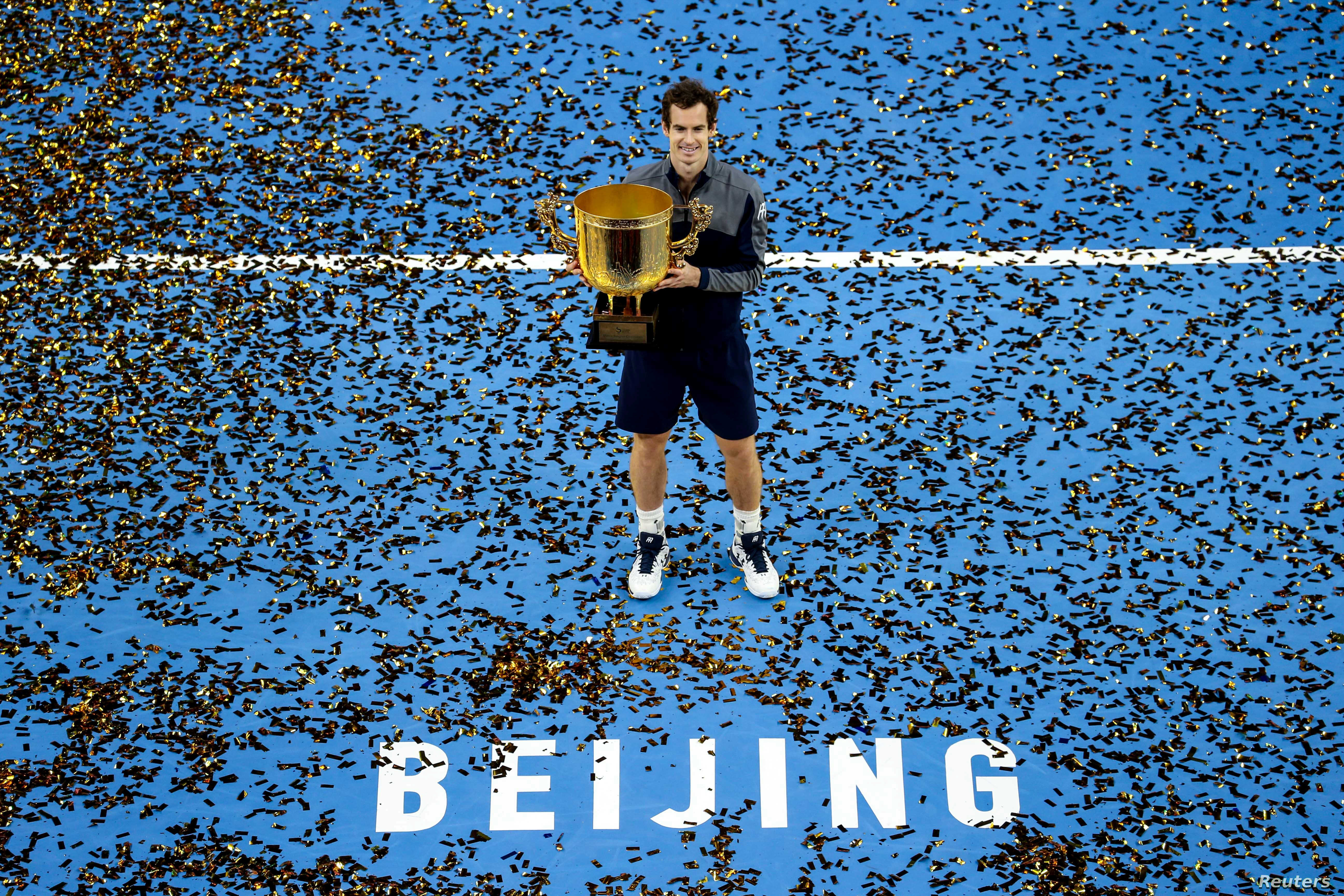 Britain's Andy Murray holds his trophy after defeating Bulgaria's Grigor Dimitrov in Beijing, China.