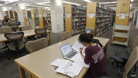 A student works in the library at Virginia Commonwealth University in Richmond, Va.