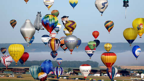 Hundreds of hot air balloons take part in the Great Line at the Mondial Air Ballons festival, in an attempt to break the 2017 record of 456 balloons aligning in an hour during the biggest meeting in the world, in Chambley, France.