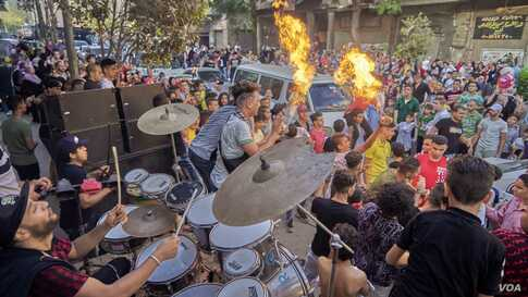 Young Egyptians gather for big streets dancing parties with DJ sound system and drums, in Old Cairo, Aug. 11, 2019. (H. Elrasam/VOA)